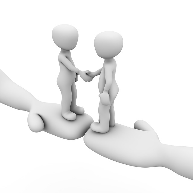 two friends holding hands, sharing trust