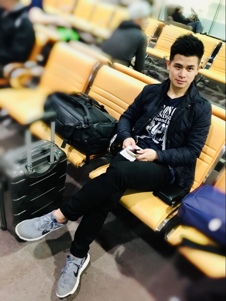 Man waiting for flight to Las Vegas